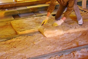 worker in attic insulation radiant barrier